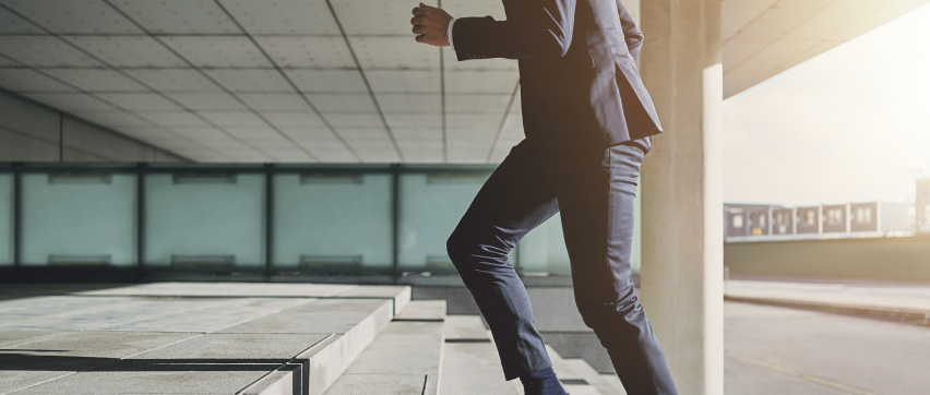 business person climbing steps to an ERP selection