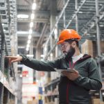 warehouse manager using advanced inventory management tools in distribution business
