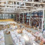 huge warehouse with distribution management software in place for purchase order management